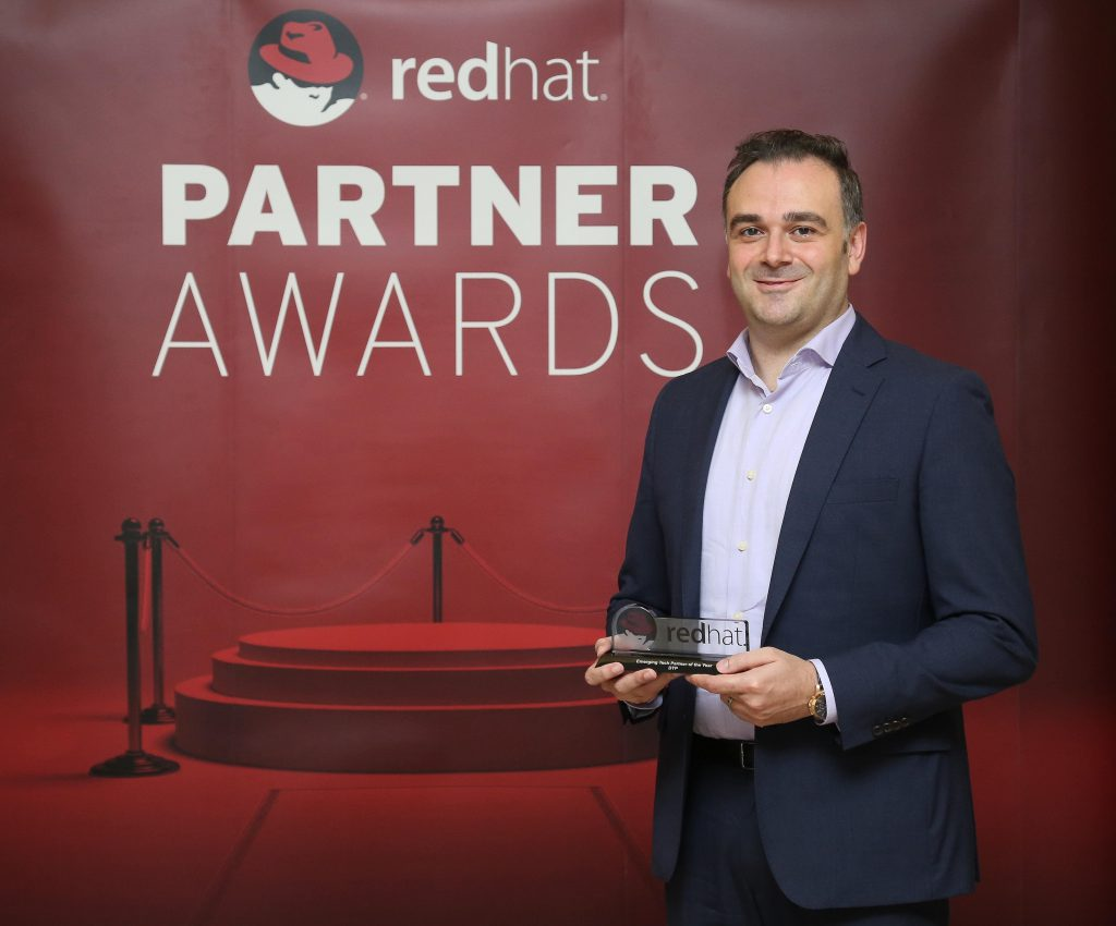 Fawaz Baroud, Account and PMO Director at DTP, accepts 'Emerging Tech Partner of the Year' award by our partner Red Hat.